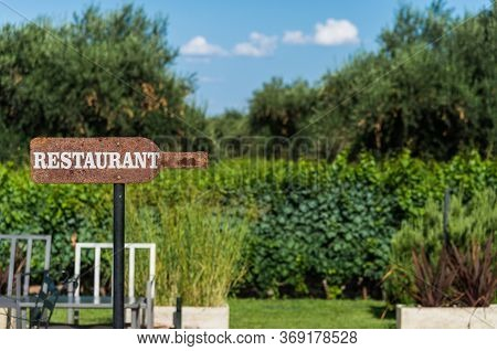 Arrow Sign Saying Restaurant. Concept Of Restaurant And Hospitality Business.