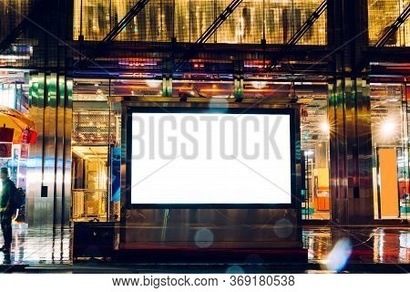 Bus Station Billboard In Rainy Night With Blank Copy Space Screen For Advertising Or Promotional Con