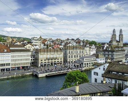 Zurich, Switzerland - May 30, 2020: View Of Grossmunster And Zurich Old Town From Limmat River. The