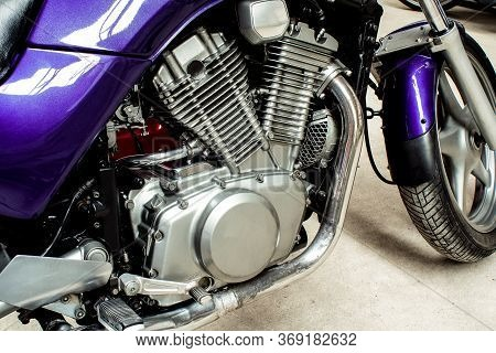 Silver V-twin Shaped Engine Of Sports Motorcycle Close-up. Pistons, Cylinders, Pedals, Gearbox, Fron