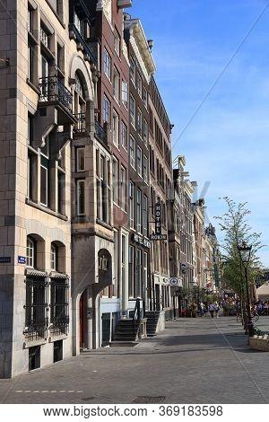 Amsterdam, Netherlands - July 9, 2017: People Visit Oude Turfmarkt In Amsterdam, Netherlands. Amster