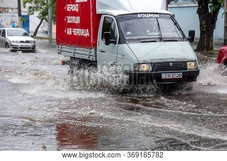 Odessa, Ukraine - May 28, 2020: Driving Car On Flooded Road During Flood Caused By Torrential Rains.
