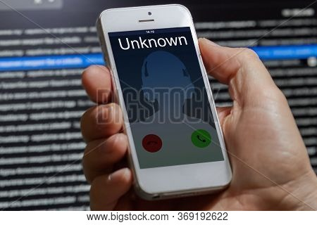Unwanted Call To A Mobile Phone On A Dark Background