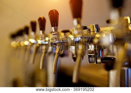 A Row Of Beer Taps In A Bar