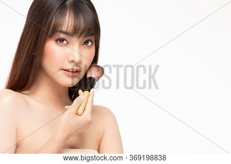 Beauty Asian Woman  Brown Hair Looking Smile In Camera Happiness And Hold Make Up Brush  And Cheerfu