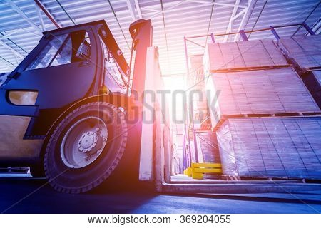 Forklift Loader In Storage Warehouse Ship Yard. Distribution Products.