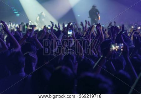Blur Of People Shooting Video Or Photo In Music Brand Showing On Stage Or Concert Live, Party Concep