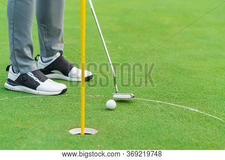 Golfer Preparing For A Putt Golf Ball On The Green During Golfcourse.