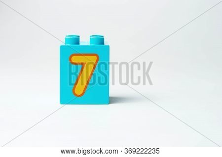 The Number Seven Written On The Block From The Childrens Constructor