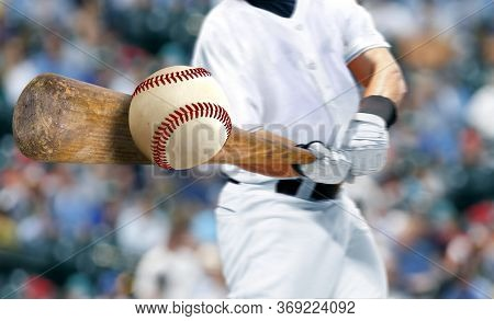 Baseball Player Hitting Ball With Bat In Close Up