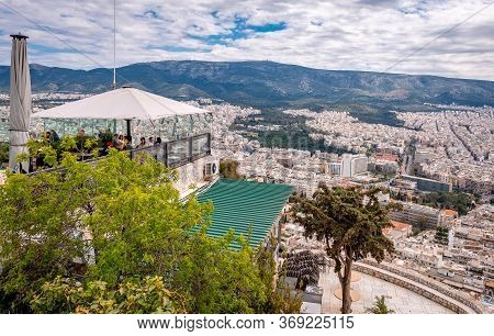 Athens / Greece - April 4 2015: People In A Cafe On Top Of Mount Lycabettus, Enjoying The Breathtaki