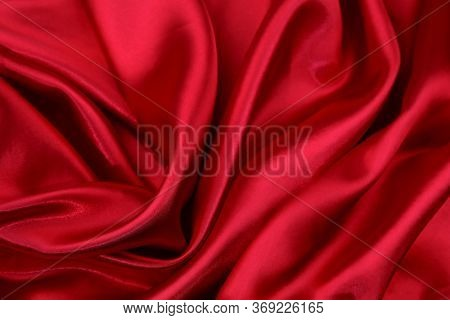 Closeup of rippled red silk fabric