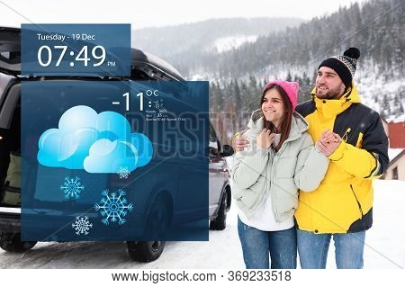 Happy Couple Near Car On Snowy Road And Weather Forecast Widget. Mobile Application