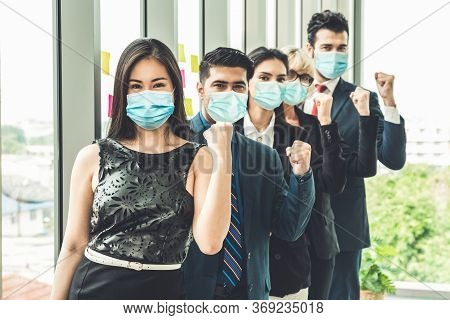 Confident Business People With Face Mask Protect From Coronavirus Or Covid-19. Concept Of Help, Supp
