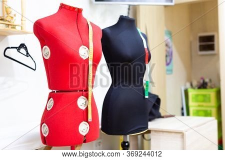 Two Headless Female Mannequins With Centimeter Tapes In Tailors Shop, Selective Focus.