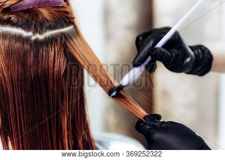 Hairdresser Applies A Hair Mask To The Woman In The Beauty Salon. Botox And Keratin Hair Straighteni