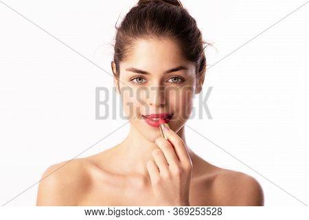 Beauty Shot Of Beautiful Woman Applying Lipstick