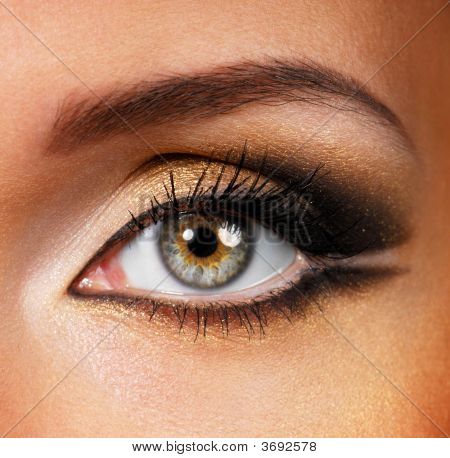 Beautiful shape of female eye with golden-brown cosmetic make-up poster