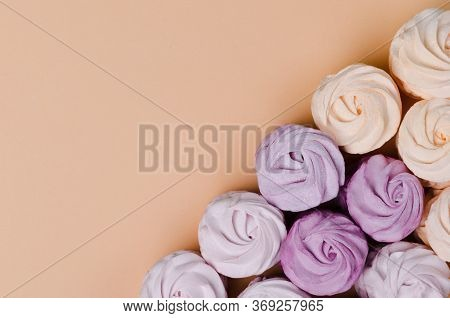 Four Marshmallows On Pastel Background. Yellow Sweet Homemade Zephyr Or Marshmallow. Flat Lay. Top V