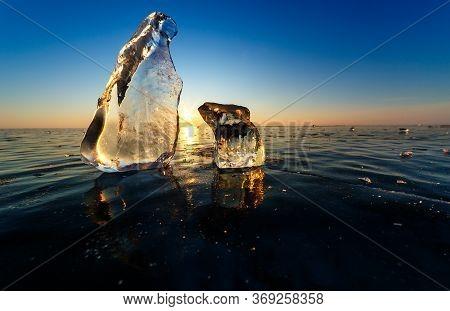Two Big Translucent Ice Blocs In The Sunshine At Baikal Lake