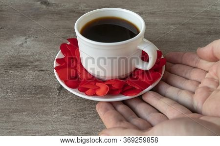 Cup Of Fragrant Coffee. Mug And Mens Hands. Romantic Theme, Making Coffee With Love..