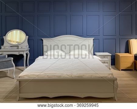 Double Bed In The Bedroom With Designer Renovation. Bedroom Interior With Furniture And Bed. New Fur