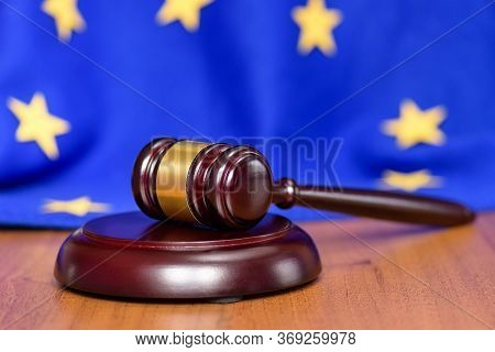 Mild Brexit Europe. Collapse Of The European Union. Eu Flag On The Background Of The Judges Gavel. F