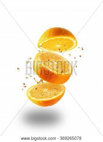 Flying Juicy Orange On A White Background. Isolated Object On A White Background. A Splash Of Orange