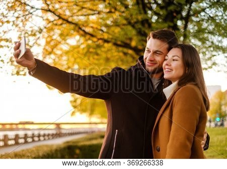 Lovely couple on a sunset making selfie