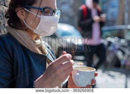 Woman With Mask In Bar Having Coffee. Covid-19 Protection. Woman Protecting From Coronavirus. Corona