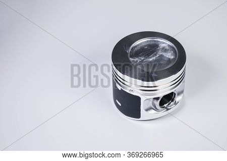 Close-up Of The New Internal Combustion Engine Piston On A Gray Gradient Background. The Concept Of