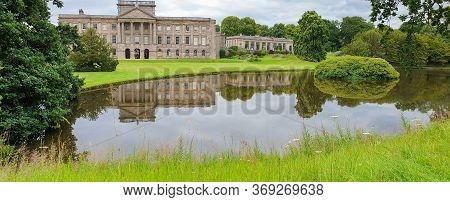 Lyme Hall Historic English Stately Home And Park In Cheshire, Uk With People Enjoying Themselves In