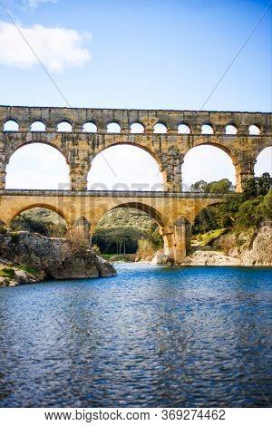 Vertical Picture Of Gardon River And Roman Aqueduct Pont Du Gard, Unesco World Heritage Site. Locate