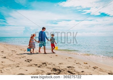 Father With Son And Daughter Walking On Beach, Family Summer Vacation
