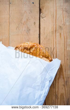 Pie Or Some Cookie In White Pack On Wooden Background