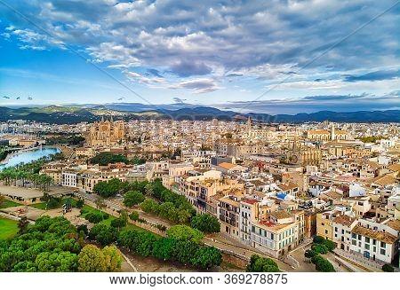 Aerial Drone View Majorca Cityscape, Famous Cathedral Of Palma De Mallorca Or Le Seu. Cloudy Moody S