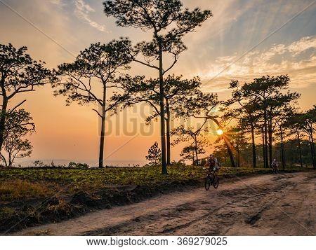 Loei/thailand-17 Feb 2019:unacquainted People Cycling With Beautiful Sunset On Phu Kradueng Mountain