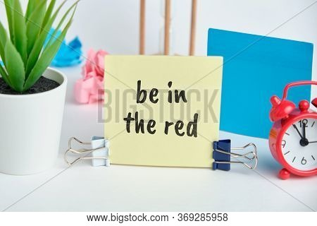 Be In The Red - English Money Idiom Hand Lettering On Wooden Blocks