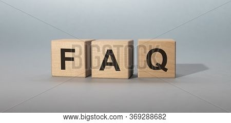 Faq Wooden Blocks Word On Grey Blue Background. Faq Frequency Asked Questions, Answer, Q And A, Info