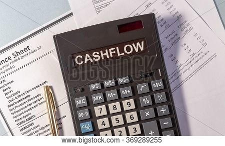 Cashflow Word On Calculator And Pen On Documents
