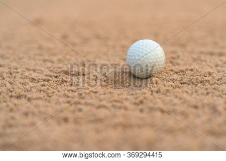Golfer Hit Golf Ball On Sand Trap Bunker At Golf Courses.