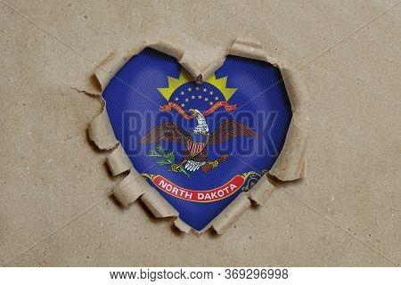 3d Illustration. Heart Shaped Hole Torn Through Paper, Showing North Dakota Flag