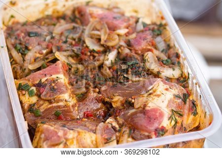 Raw Marinaded Juicy Pork Meat In Plastic Container. Fresh Food Prepared For Barbeque. Summer Cooking