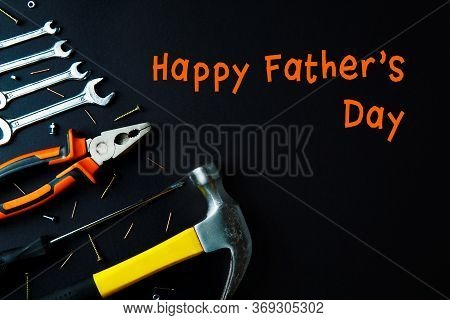 Construction Tools For Home Renovation Orange And Yellow Colors On Black Background. Happy Fathers D