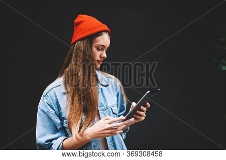 Young Attractive Female Beauty Blogger Holding Modern Touchpad