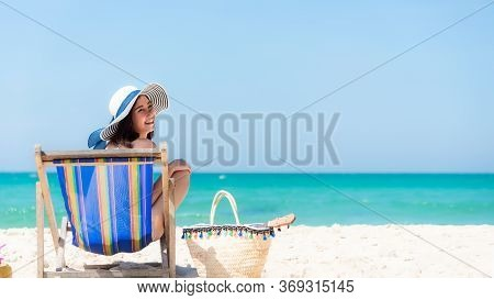 Lifestyle Young  Woman Relax On The Summer Beach.  Asia Tourism People Sitting On Chair Beach And Ch