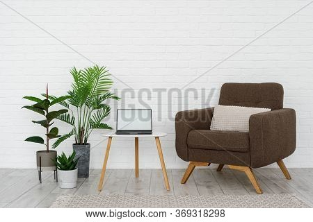 Minimalist Interior Of Living Room With Cushioned Furniture, Comfortable Armchair, Wooden Triangular
