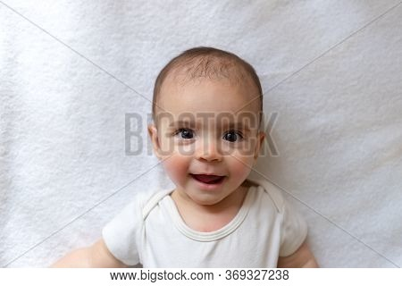 Newborn Baby. A Little Boy In White Clothes. Beautiful Portrait Of A Toddler. Big-eyed Baby.