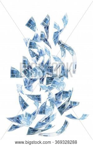 One Hundred Brazilian Banknotes Falling On White Isolated Background. Concept Of Fortune, Wealth, Mo