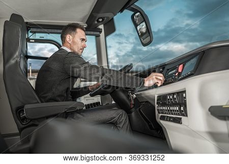International Bus Driver Preparing For Another Trip. Caucasian Motor Coach Driver In His 30s Inside